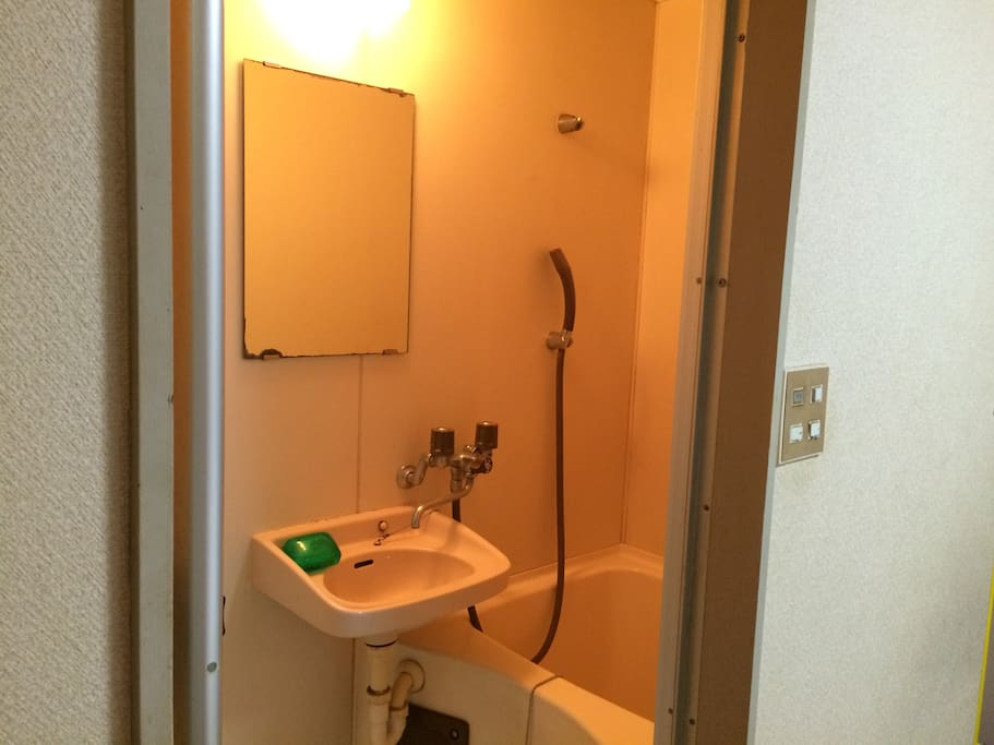 Bathroom with sink and shower. Shampoo, conditioner and body soap included. We also provided you with towel.