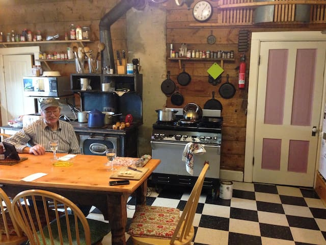 The kitchen, 6 burner commercial Wolf and wood stove that well still cook on.
