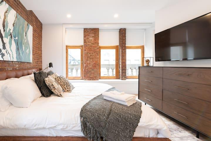 "Master Bedroom 1 - King Size Bed. Mounted 50"" TV. En-Suite Bathroom."