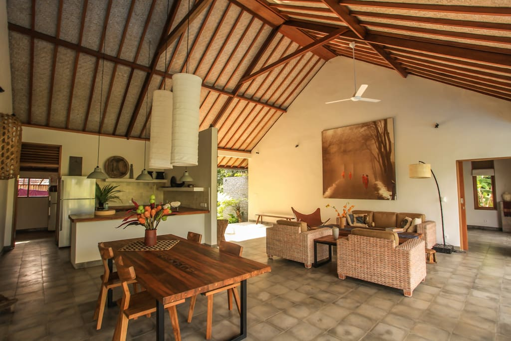 Open living with recycled teak counters and tables.
