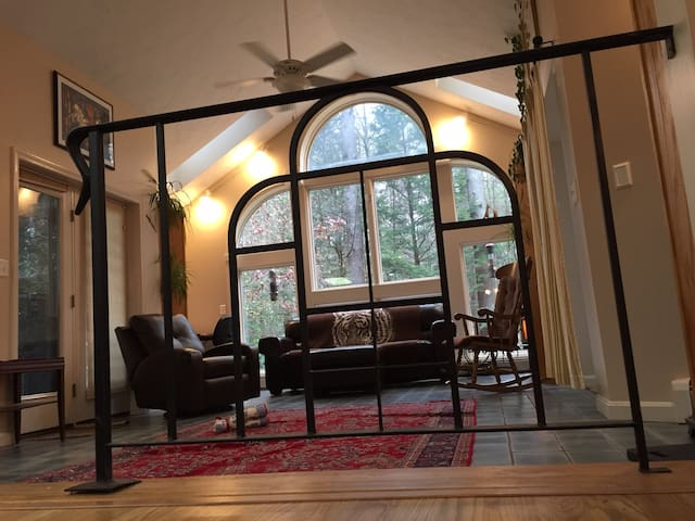 The guard rails into the main living area were designed in the same pattern as the great arched window.