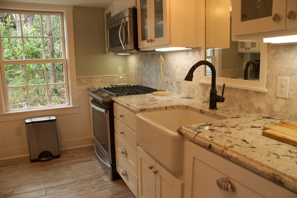 Kitchen has farmhouse sink, dishwasher, gas stove and much more!