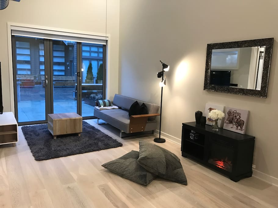 Open space with sofa bed.  Walks right out to Patio