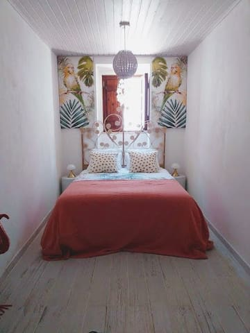 Large bedroom with decoration reflecting the local flora.