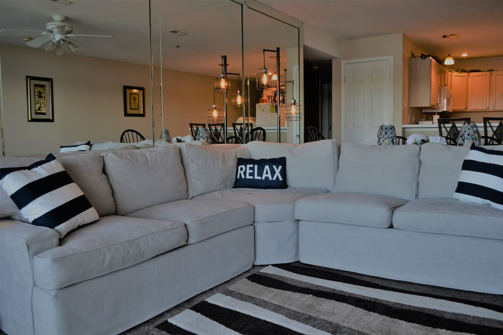 Living Room with tons of seating, perfect for rainy day or movie night!