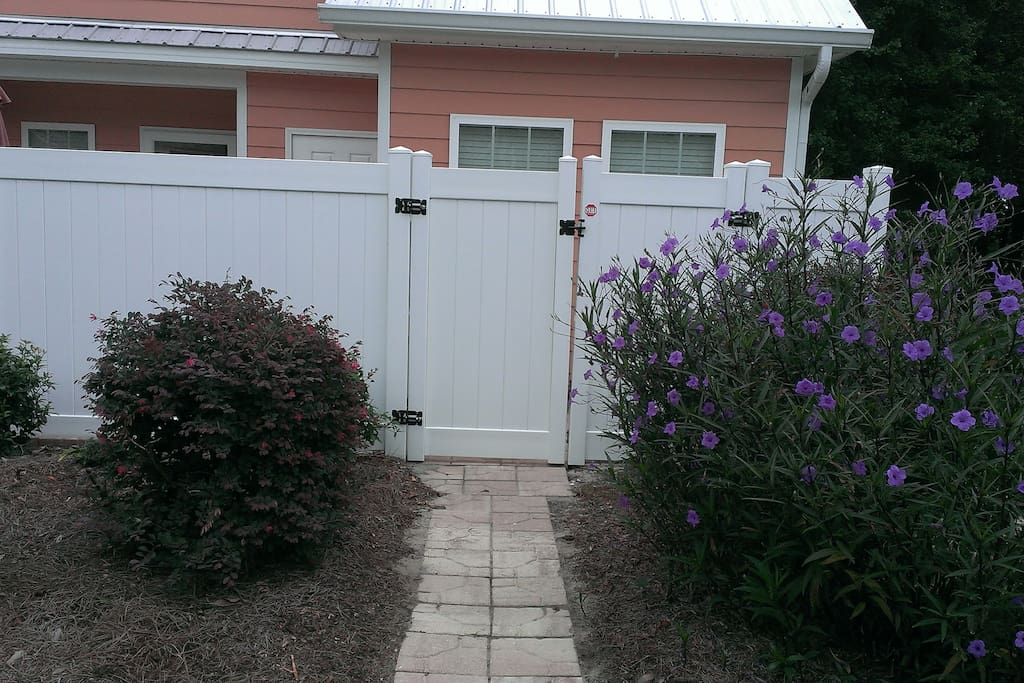 Private back entrance secured and pavers sidewalk.