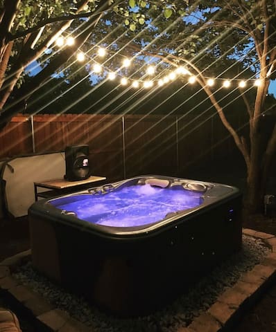 Hot tub tucked away in the corner of the back yard for relaxing
