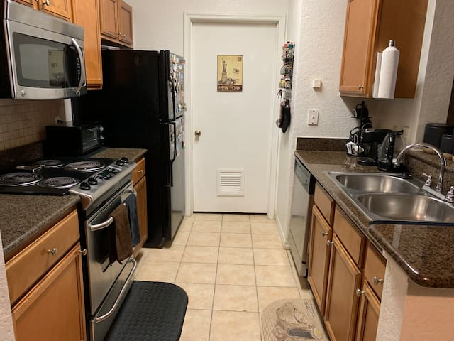 A fully equipped kitchen is available for guest use between the hours of 8am-9pm. Stove, oven, microwave, toaster, hot water kettle, pans, mixing bowls, casserole dishes, strainers, cooking utensils, and a crockpot are all provided for convenience.