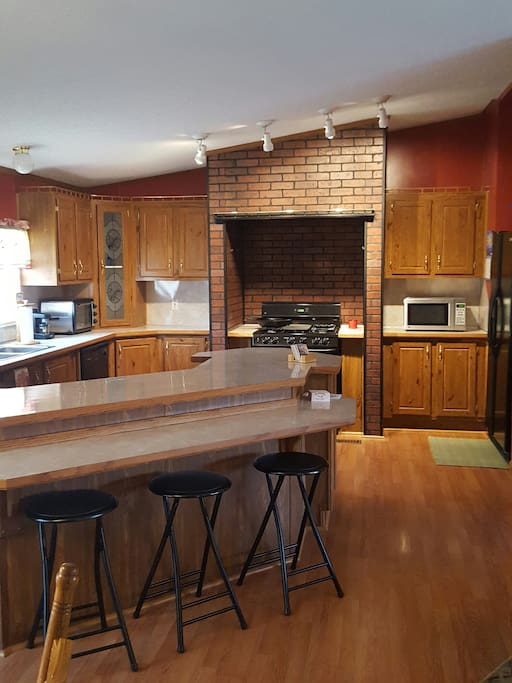 Well equipped large kitchen with counter seating. Amenities include microwave,toaster oven, coffee bar, espresso machine, and press.  Blender, ice maker and water in door. A second small refrigerator for drinks and freezer space.