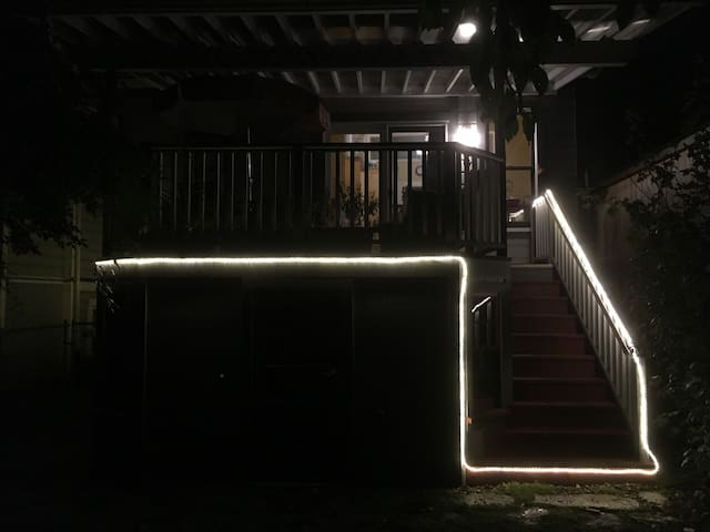 After dusk, LED rope lights show the way around the shed and up the deck stairs