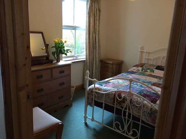 Main double bedroom with double glazed sash window looking out to our private patio.