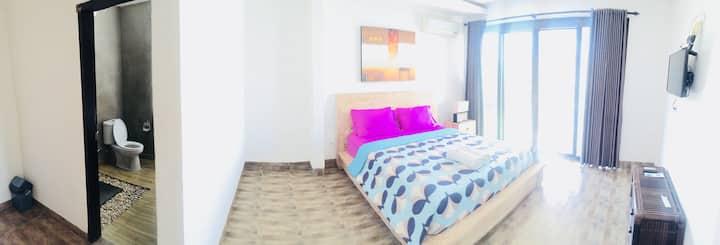 Keramas room queen bed en-suite overlooking pool