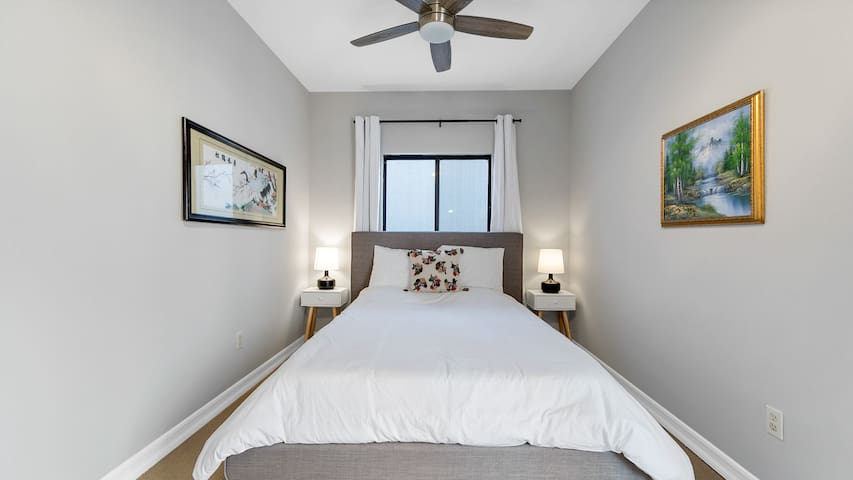 Second Bedroom with Queen Bed and its own entrance to Backyard/Pool Area.