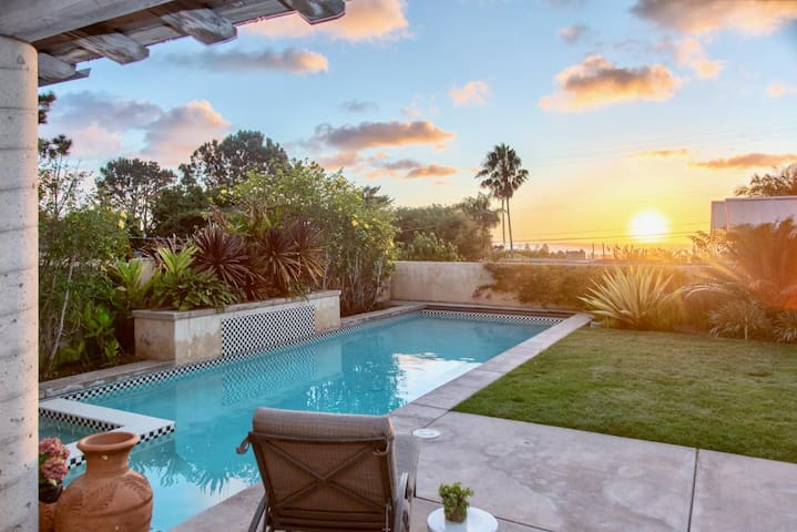 Hacienda Bliss: Gather the family to sunbathe by the pool with an ocean view in this custom home