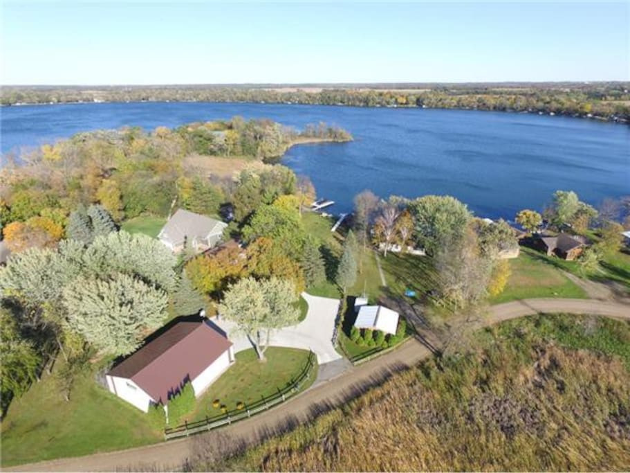 Beautiful 1 acre yard with several tree swings, apple trees and grape vines!  Lots of concrete parking. Boat launch is right around the corner!