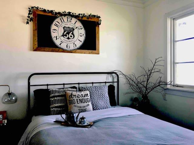 The Garden Room Queen bedroom with beautiful outlook. Electric blankets, wall heater, fan, cot & work space