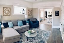 The living room greets you as you enter. The couch pulls out into a queen size sofa bed.