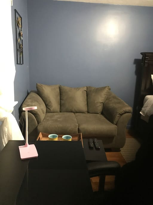 Relax on this comfortable sofa while watching tv and enjoying some yummy gourmet coffee on the host.