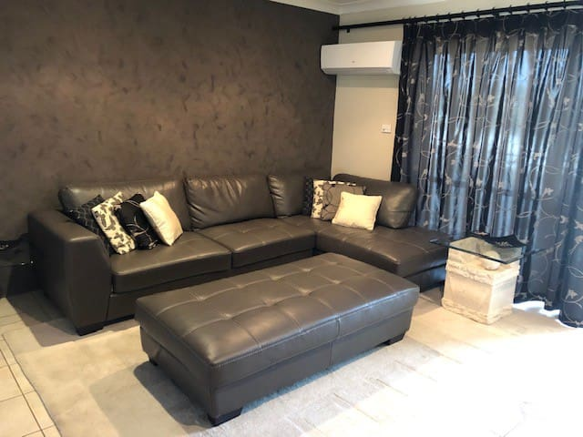 Lounge with seating for 6 and large ottoman