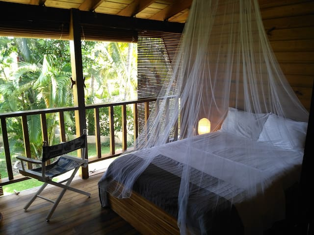 Open bedroom with the view over the garden (wooden shutters can be closed)