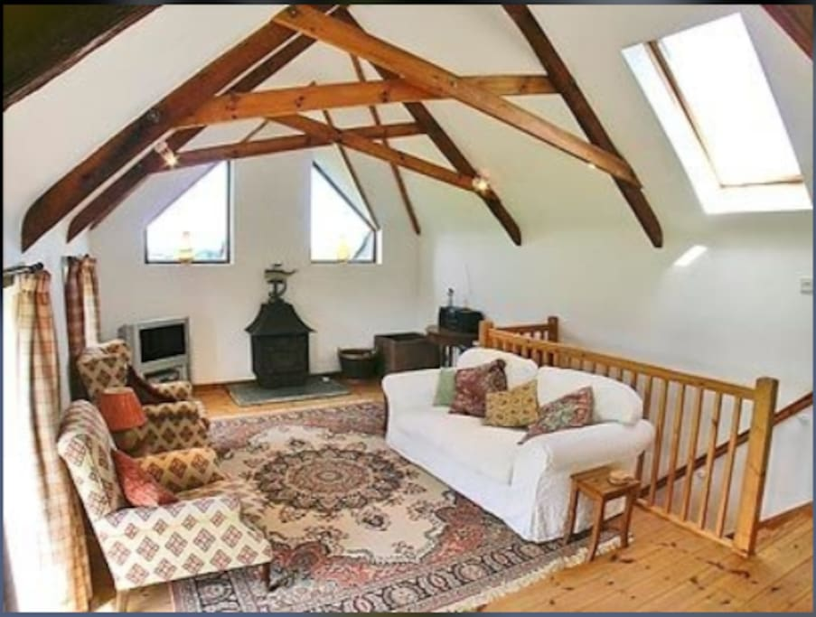 Upstairs sitting room with views over rolling countryside