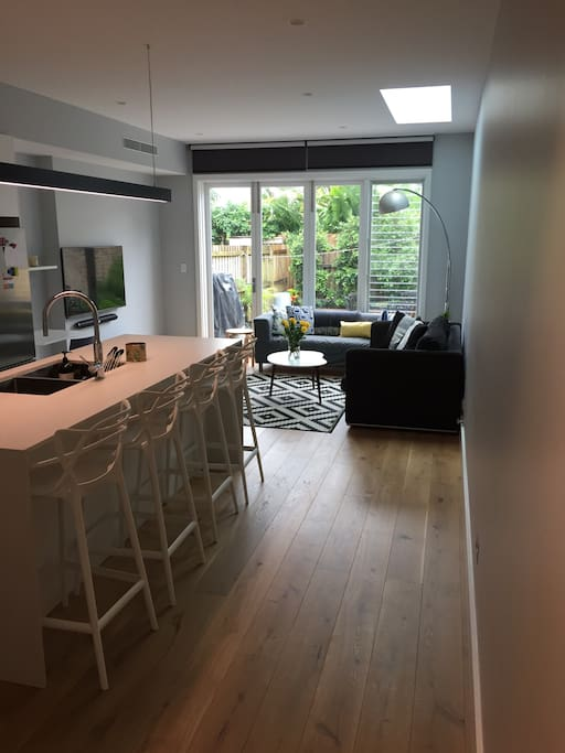 Open plan kitchen & sitting room with TV (Netflix), lots of natural light, 2 sofas & black out blinds.   This room has reverse cycle air conditioning.