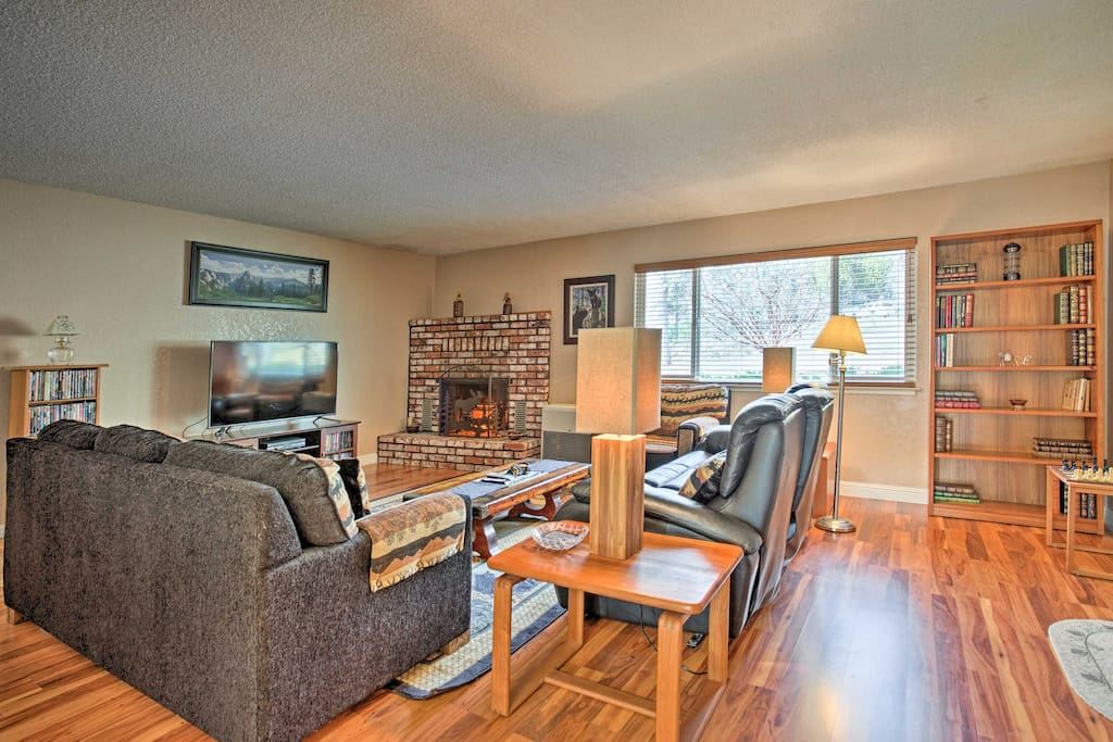 Spend time with loved ones in the living room with plush couches and a flat screen TV.