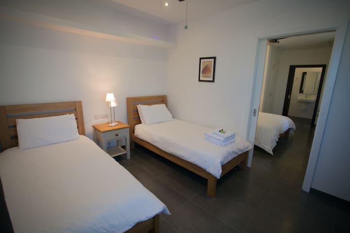 Third bedroom with connecting door to second bedroom.