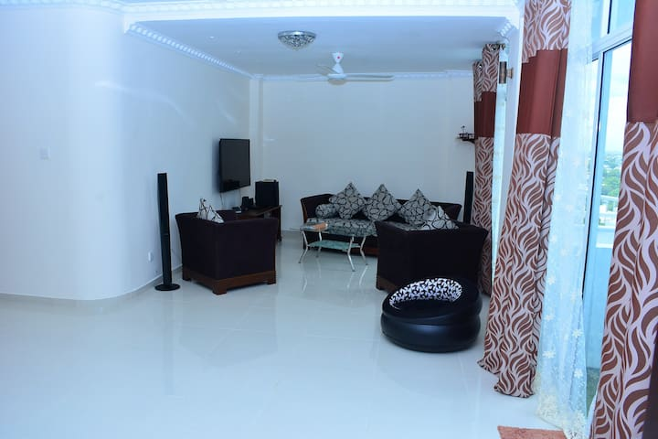 Sitting room with sofa, 55 inch TV,home theater sound system etc.