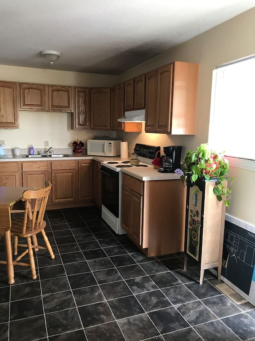A very large kitchen with small dinette set. Fully equipped. Washer and dryer off the kitchen in a separate laundry room.