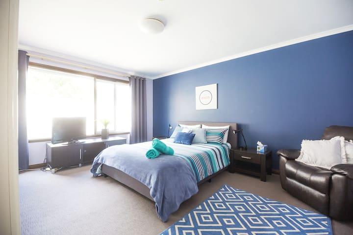 bedroom 2, queen bed, TV, recliner arm chair