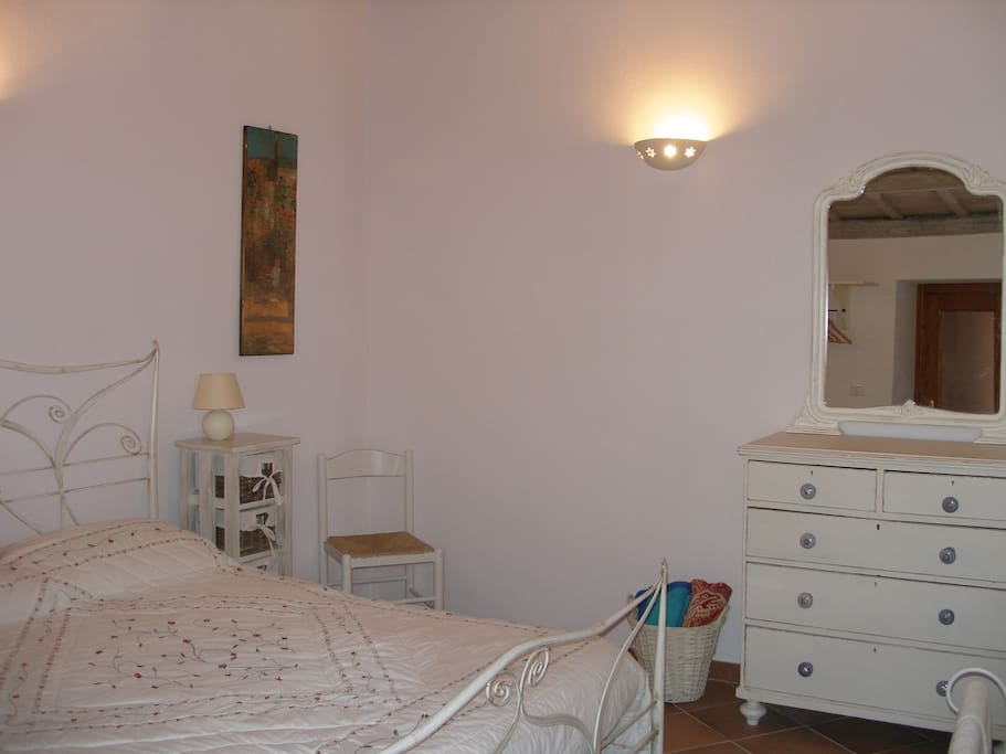 Spacious bedroom with large bed - air conditioned for comfort