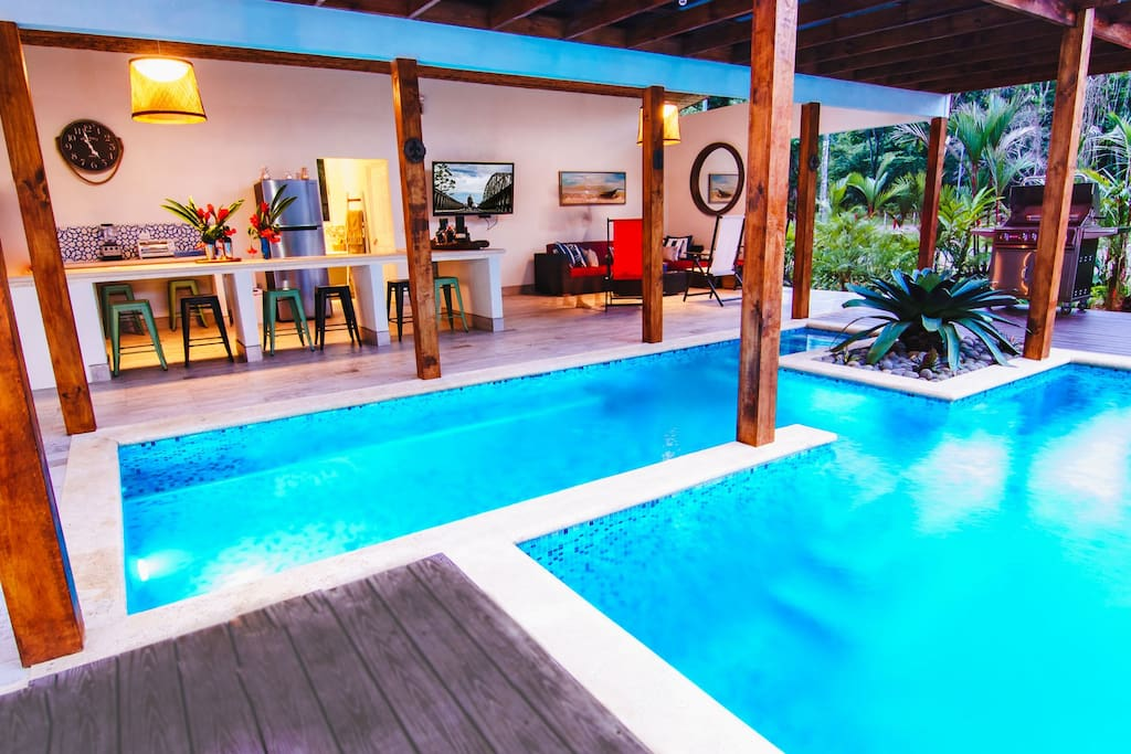 Swimming pool and outdoor kitchen, with large flat screen TV, full bathroom, BBQ...