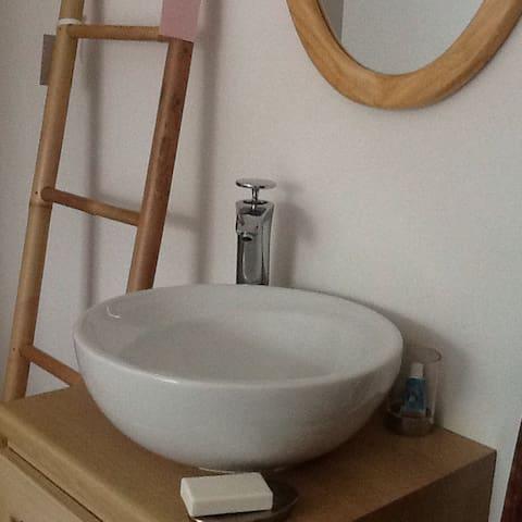 Sink and vanity unit in bedroom