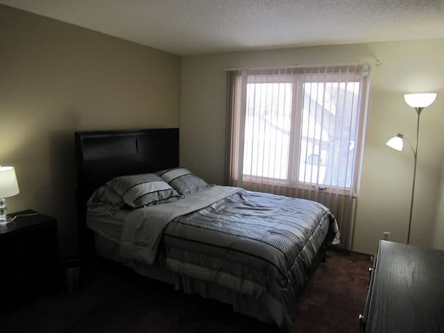 Master Bedroom With Private 2-pc Bathroom - Okotoks