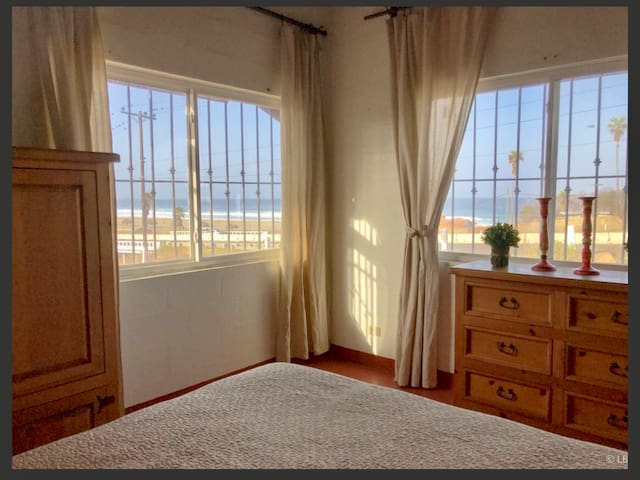 Bedroom looks out onto beach across the street.