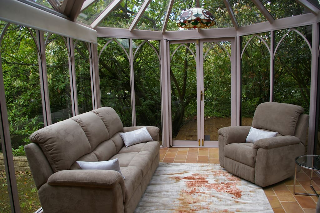 Large conservatory adjoins the building.