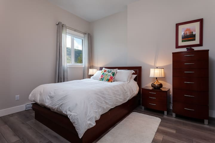 Queen size bedroom with private full bath.
