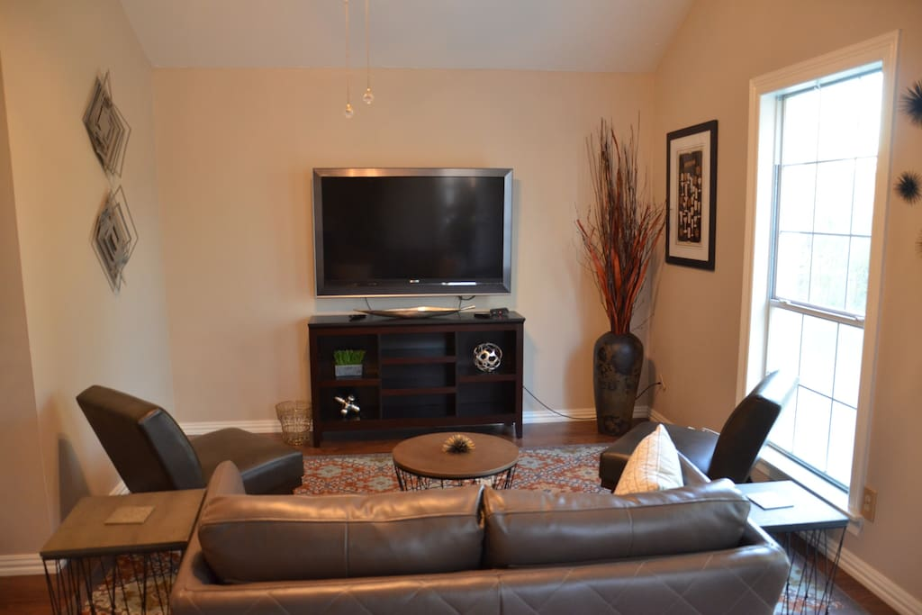 """The main living area, 55"""" TV with cable"""