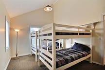 """Four brand new single bunks--each of which has a 4"""" memory foam topper."""