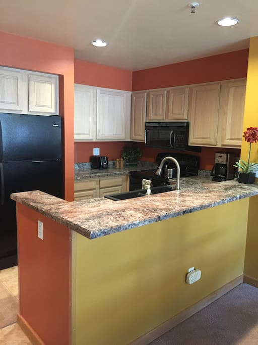 Renovated kitchen featuring full size appliances & granite countertops