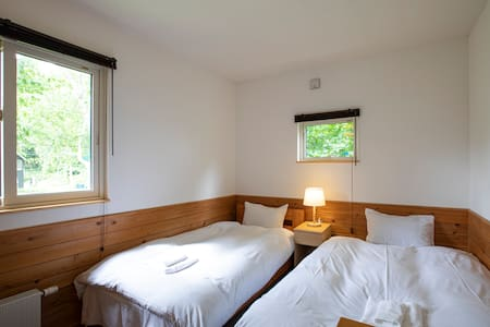 Single bed is to the left, the larger bed to the right is a sofa bed and is normally set as a sofa