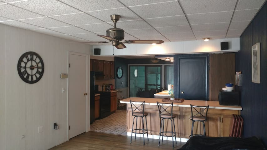 full kitchen with refrigerator, dishwasher, stove and laundry area.  Connects to boat well behind it.