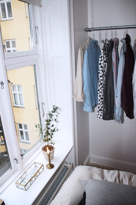 A glimt of the clothes rail and the beautiful view of the courtyard.
