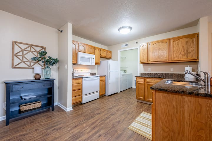 The kitchen is open and spacious with laundry nearby.