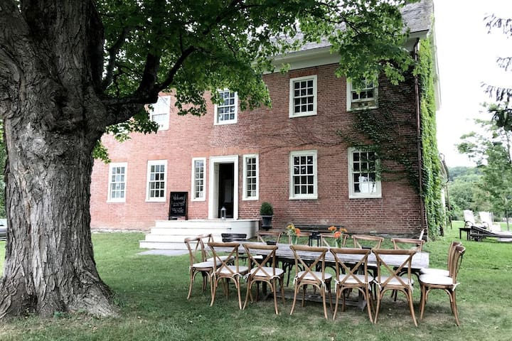 Windrift Hall is perched high on a hill in the shade of a 250 year old maple tree