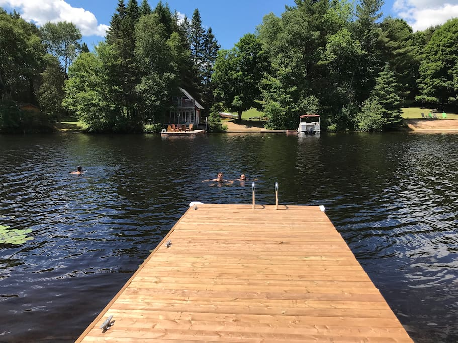 Swimming off the dock.  Shallow from the sandy shore but deep at the end of the dock for jumping in.