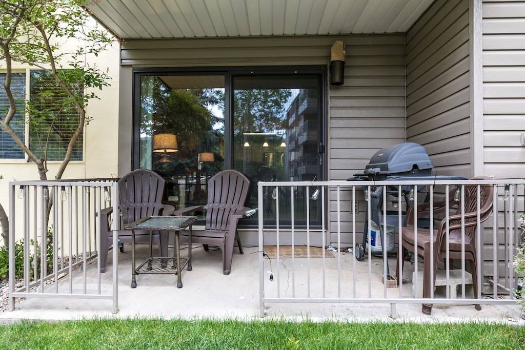 The patio offers outdoor seating and a grill