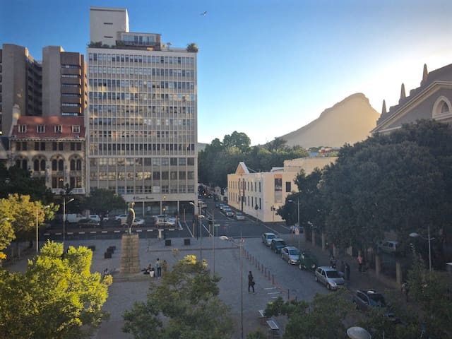 View of the apartment block, the Slave Lodge and Lion's Head mountain from across Church Square