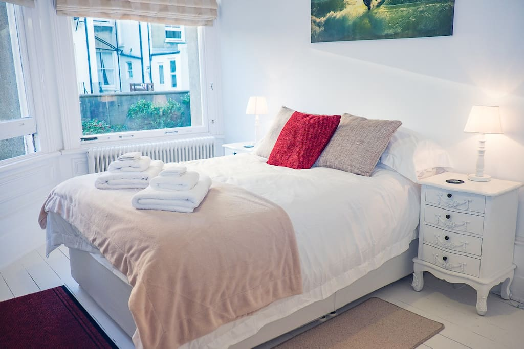 Main Bedroom with double bed and hanging space for clothing